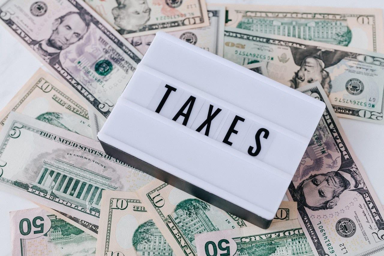 taxes sign on money